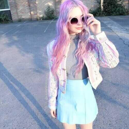 Kayla Hadlington's Pastel Grunge Outfit with Pastel Denim Jacket, Gray Sweatshirt, Pastel Skirt and Pink Sunglasses