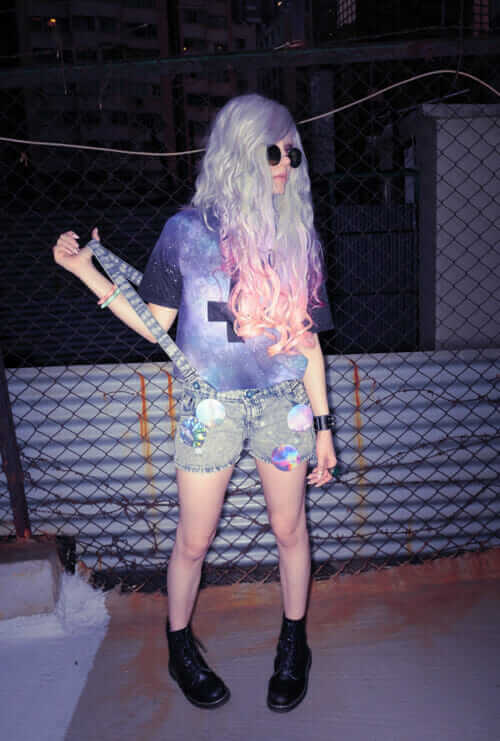 Pastel Grunge Outfit with Pastel Purple and Blue Dyed Hairstyle, Cross Galaxy Graphic Printed Tee, Denim Shorts, Dr Martens Boots and Sunglasses