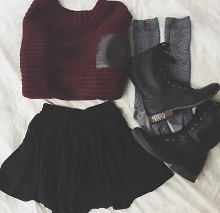 Grunge outfit idea nº1: Red sweater, combat boots, knee socks, and a simple black skirt