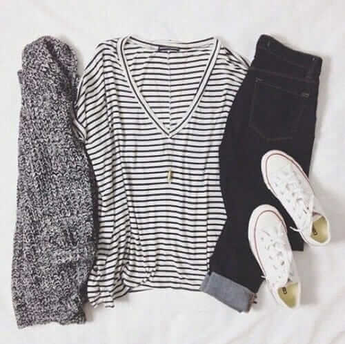 Grunge outfit idea nº11: Striped V-neck T, chunky scarf, dark rolled denim jeans, and white low-cut Converse all-stars