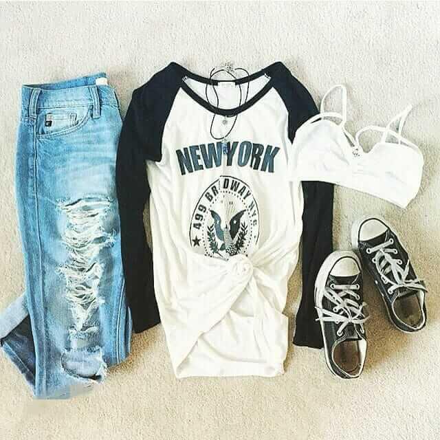 Grunge outfit idea nº12: Blue sleeve Varsity T, navy Chuck Taylors, and shredded blue jeans