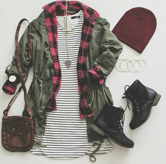 Grunge outfit idea nº16: Red plaid shirt, striped dress T, green canvass jacket, red beanie, black laced boots, brown leather bag, and matching accessories