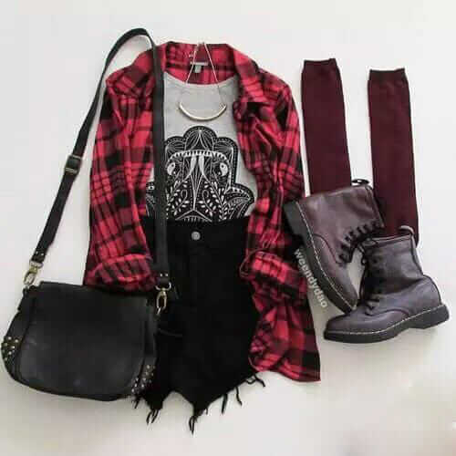 Grunge outfit idea nº4: Flannelette shirt, black ripped jean shorts, studded handbag, maroon knee highs, combat boots, and a half bangle necklace