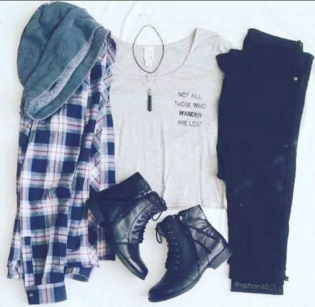 Grunge outfit idea nº6: Flannel shirt, boots, black jeans, light grey sleeveless undershirt, and black crystal necklace