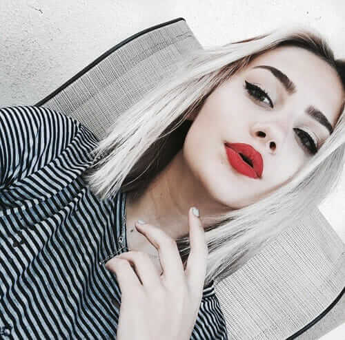 Cute Pale Grunge girl with Red lips makeup