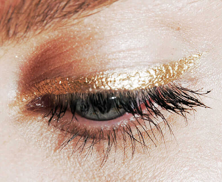 Metallic gold Vanille winged eye liner and sparkly shadow