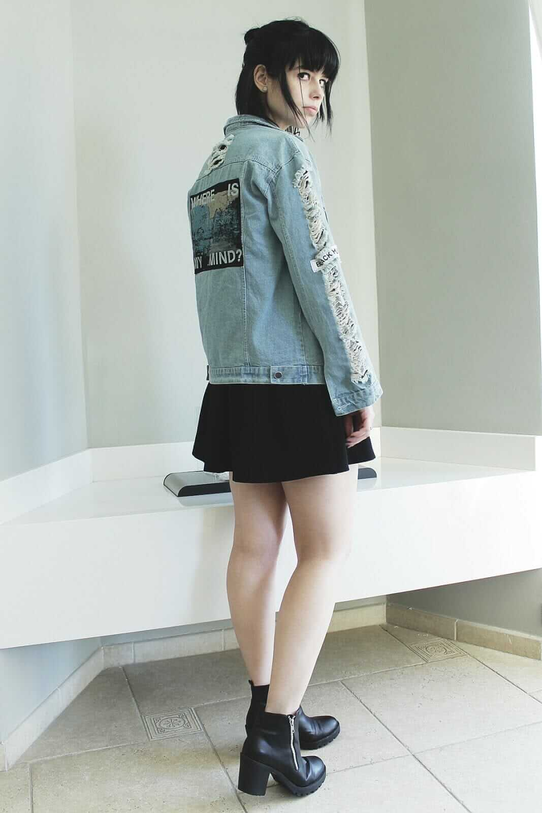 Denim jacket with patches, Chain necklace, Black skater dress & black ankle boots
