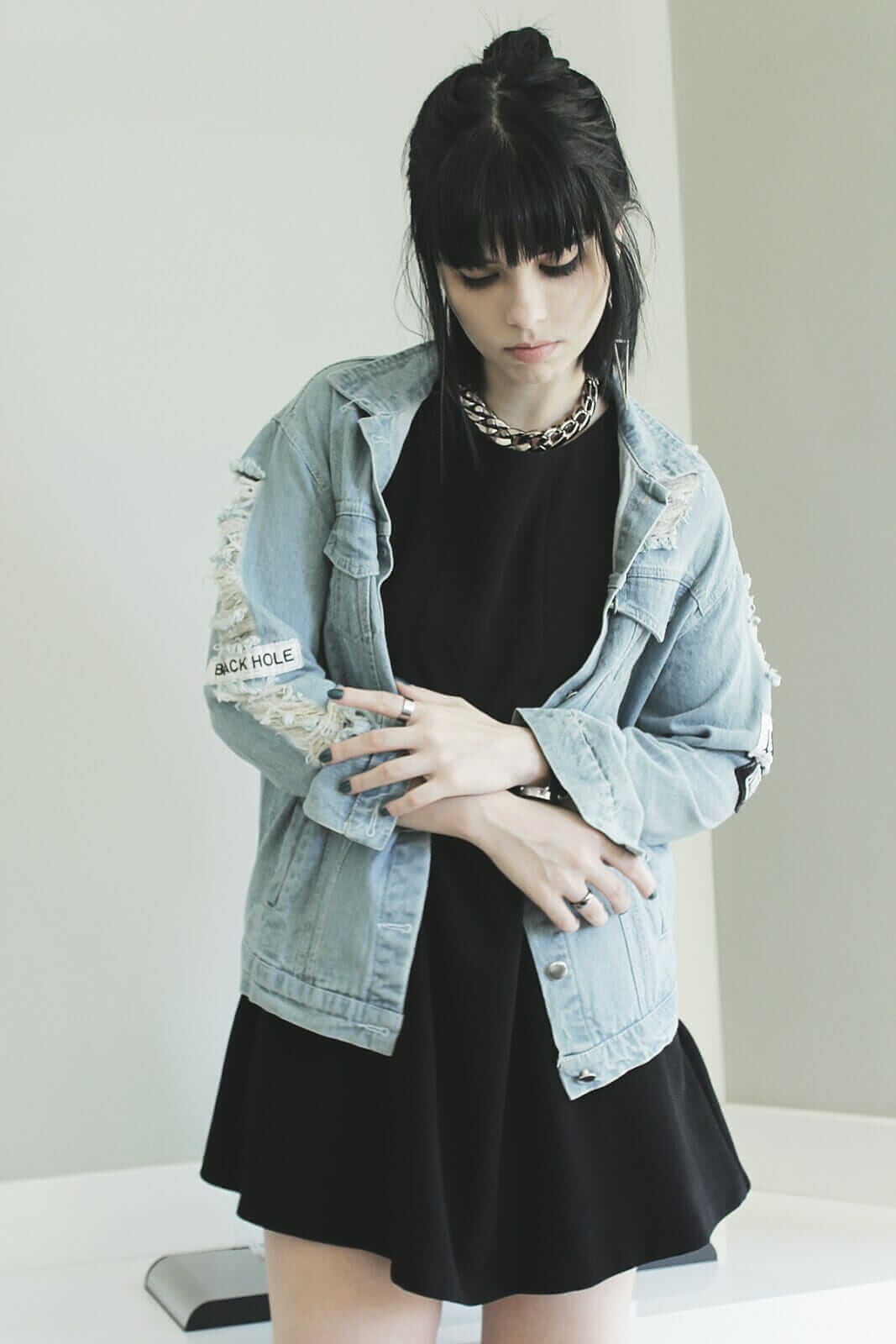 Denim jacket with patches, Chain necklace & Black skater dress