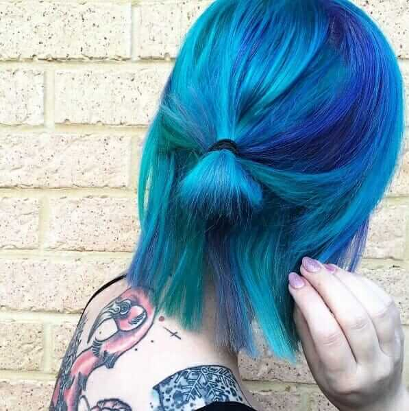 Inked girl with turquoise dyed short hair