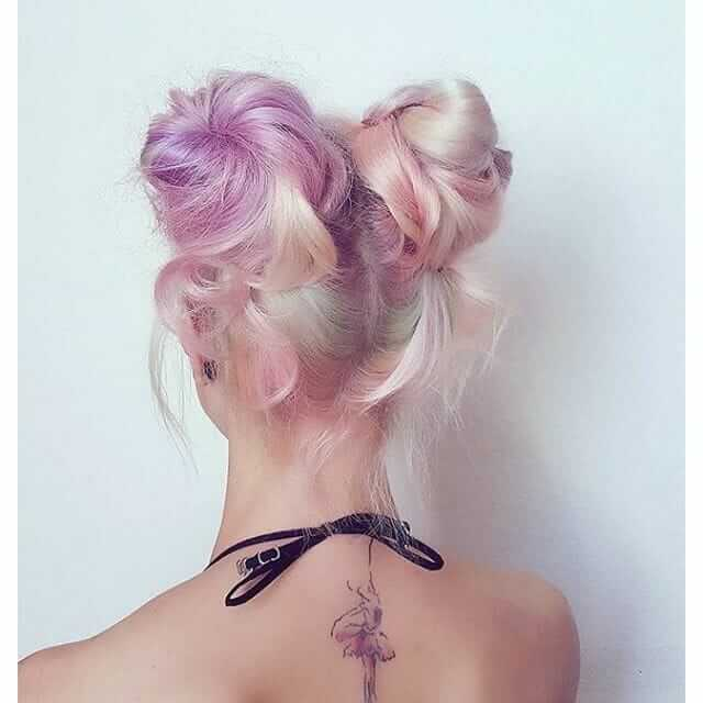 Multicolored pastel hairstyle with buns