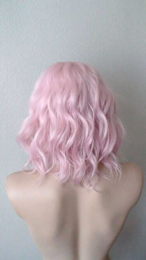 Pastel pink curly dyed hair