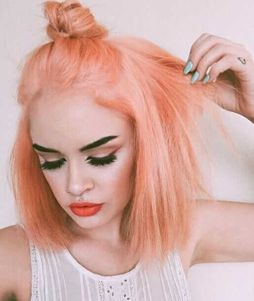 Pastel pink dyed short hair with top knot