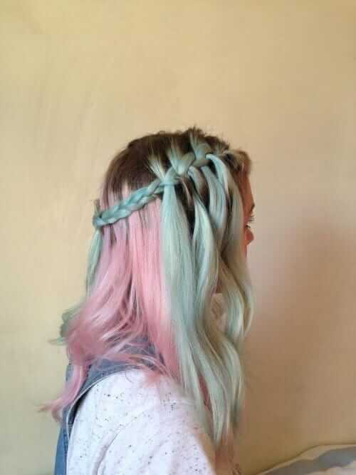 Pink and turquoise dyed hairstyle with dark roots