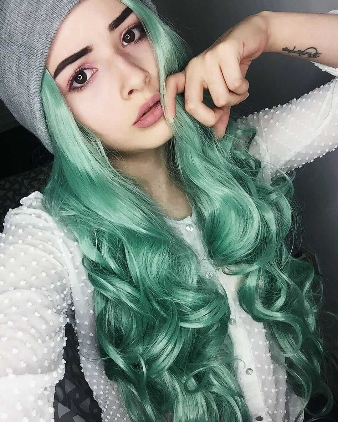 Pastel green hair dye on long wavy hairstyle by patricia.echeverria