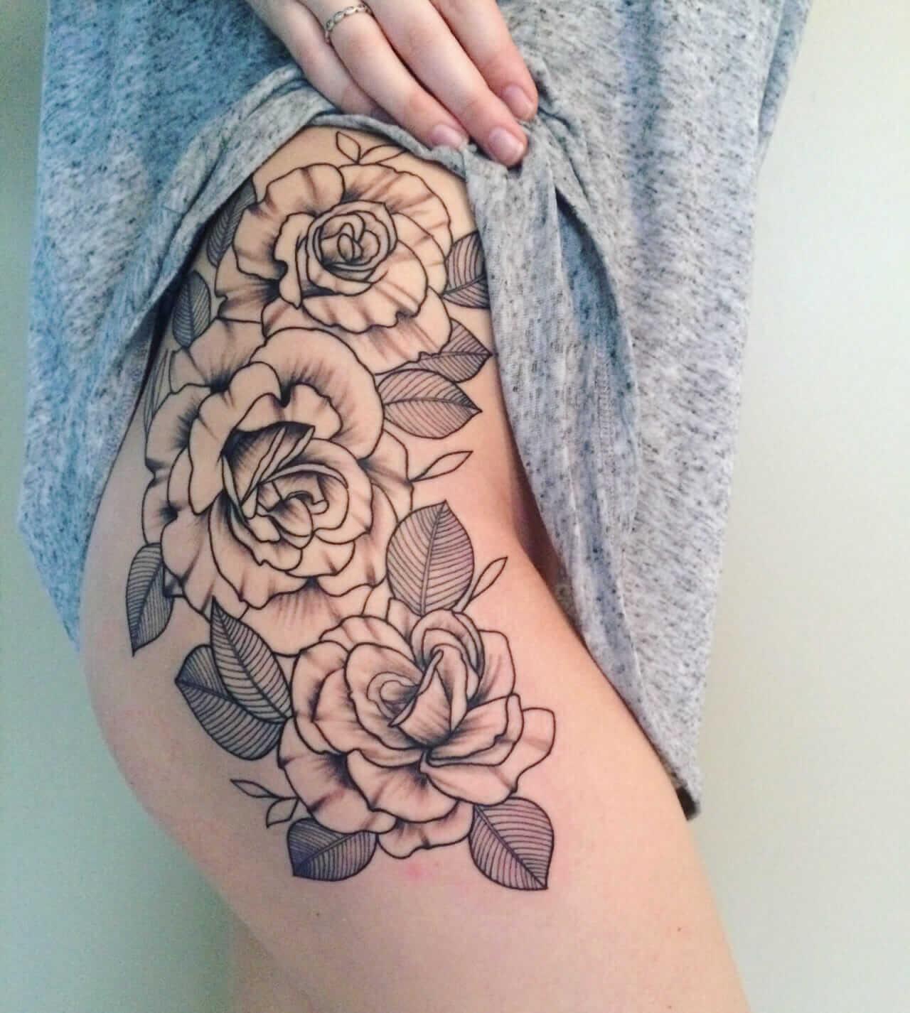 Roses tattoos on hip-thigh