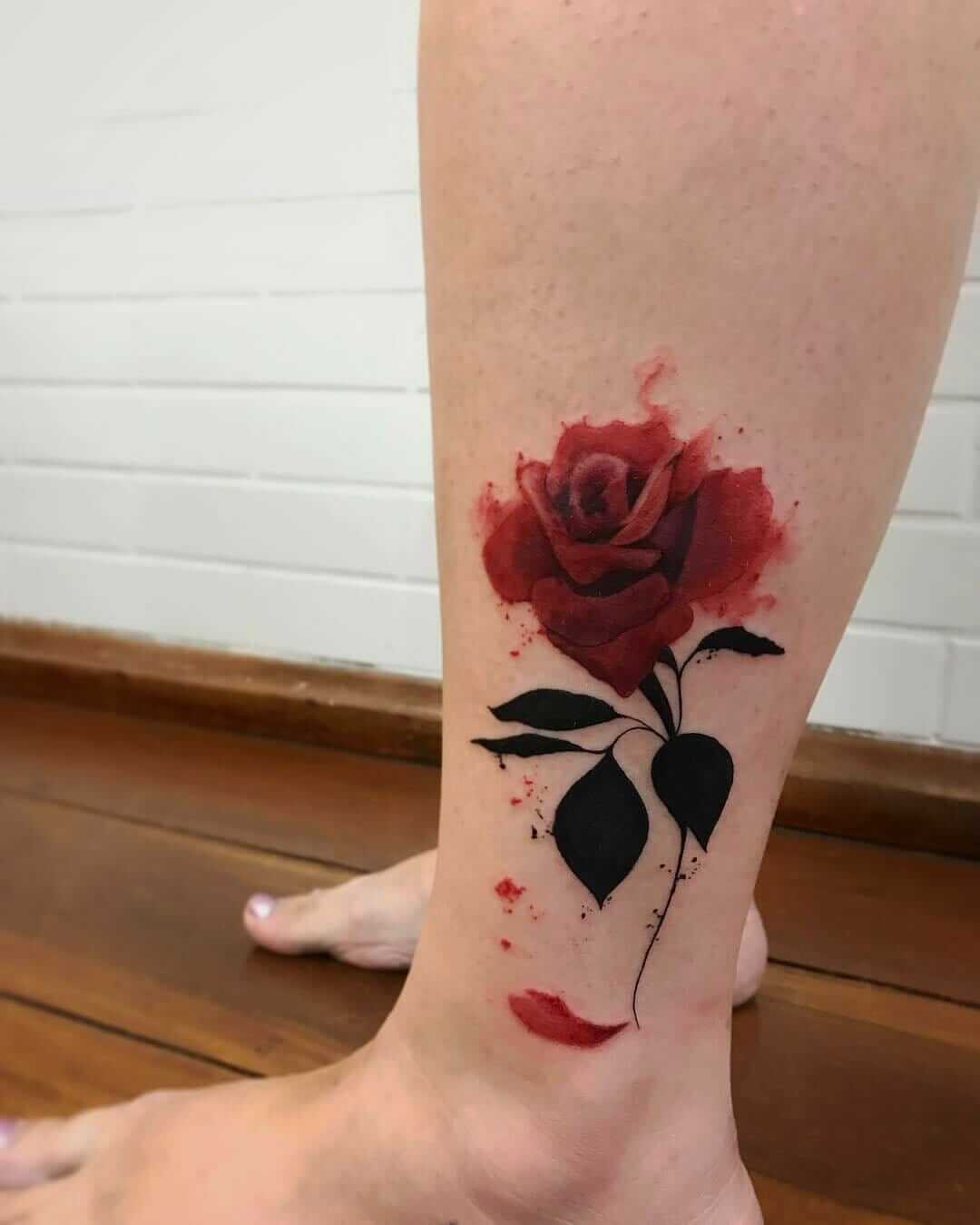 Colored rose flower tattoo on ankle by lcjuniortattoo