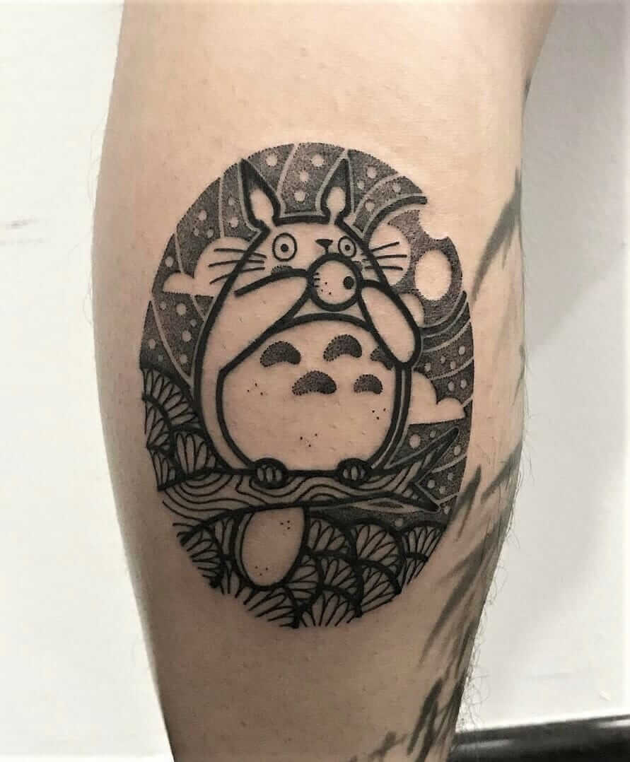 Totoro on branch tattoo by hugotattooer