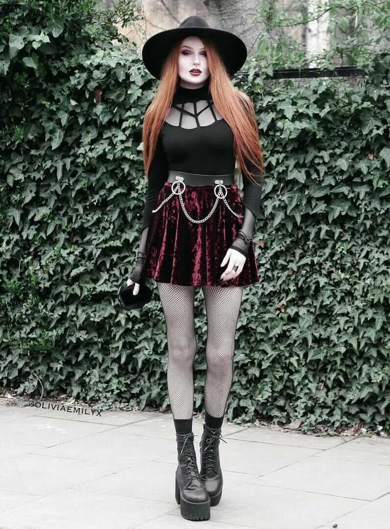 Long black hat with Arachnid Doll Top, velvet skirt, fishnet tights and platform boots by oliviaemilyx