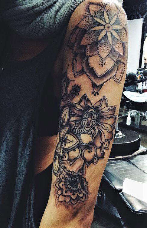 Half sleeve flowers tattoo