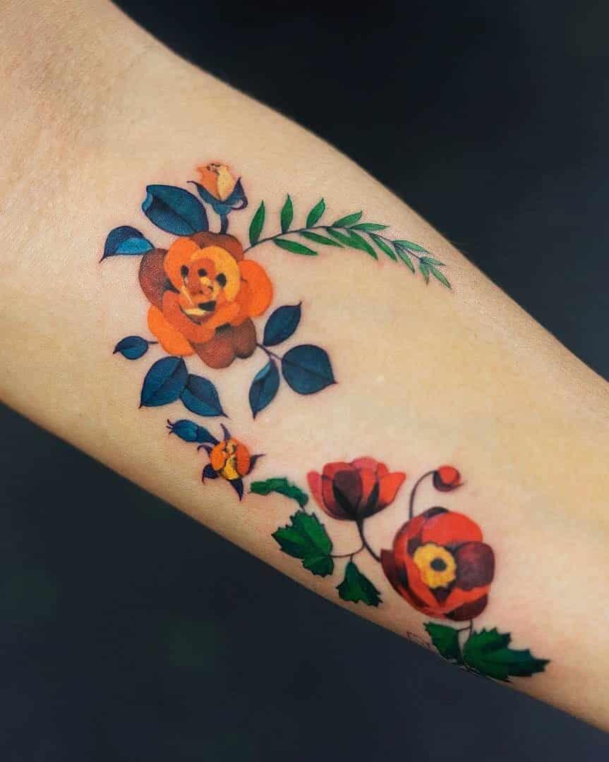 Multicolored flowers tattoo