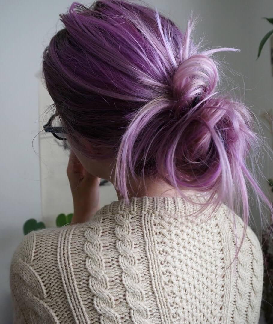 Purplish pink dye with bun haircut by aliencreature