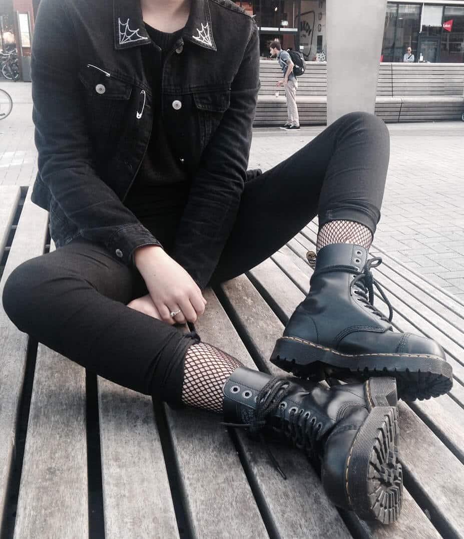 Black denim jacket with tee, black pants, fishnet leggings & black Dr Martens boots by lilithlovegood