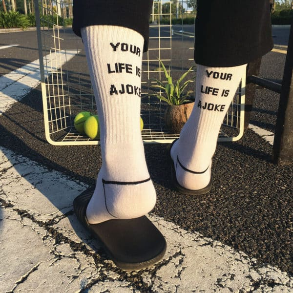 """Your Life is a Joke"" Socks"